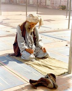pakistan man praying    I took this in 1987 of a man praying in Peshawar. We were being given a tour of the mosque. by yumievriwan, via Flickr