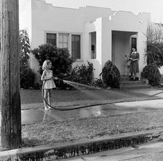 * Not originally published in LIFE. * Natalie Wood waters the lawn as her mother, Maria Gurdin, supervises, 1945.