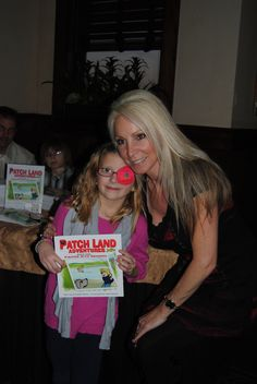 During my book signing.How cute is she!