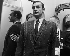 Savile Row Tailor Recreates James Bond's First Suits - Businessweek.  When Terence Young, director of the 1962 film Dr. No, needed help convincing James Bond creator Ian Fleming that former boxer Sean Connery was perfect for the role of the refined secret agent, he sought out Fleming's Savile Row tailor, the late Anthony Sinclair.  Sinclair is shown fitting Connery for a bespoke suit.  He made the actor wear them 24 hours a day for weeks until he learned how to carry himself properly in a…