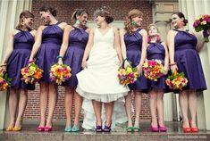 I think this idea sends a great message from the wedding party...we're alike in many ways, but we still embrace our individuality. ORRRRR---its just a great idea because its different and its a POP of color...LOL