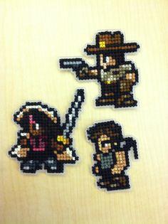 Walking Dead cross stitched patches. Custom designed from modified final fantasy 6 sprites.