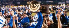 BYU wins the 1984 National Championship in football. San Diego - December 21, 1984. The Cougars defy all odds, completing a perfect, undefeated 13-0 season, capped by a 24-17 victory over Michigan in the Holiday Bowl - events which combined with a series of upset losses by traditional powerhouse schools - led to the Cougars being named concensus national champions of college football.