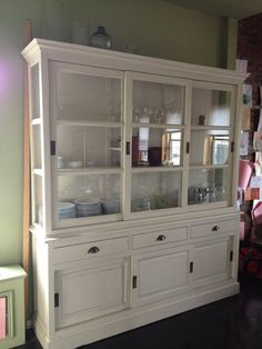 Gorgeous off-white hutch from ABC Carpet and Home. Glass upper cabinet with sliding panel doors and adjustable shelves. Sliding Panels, Panel Doors, White Hutch, Ny Usa, Lower Manhattan, Upper Cabinets, Adjustable Shelving, New Kitchen, China Cabinet