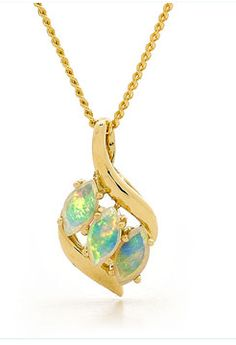 A stunning Gold Opal pendant in opulent design.Our Jeweller team uses three solid light opals sourced from quality opal mines in Coober Pedy, South Australia. Our design team sets the Australian Solid Light Opal pendant in 18k yellow gold and creates a traditional multi stone pendant.Multi marquise pendant design, this pendant is great for day to day wearing or for any special occasion. #opalsaustralia