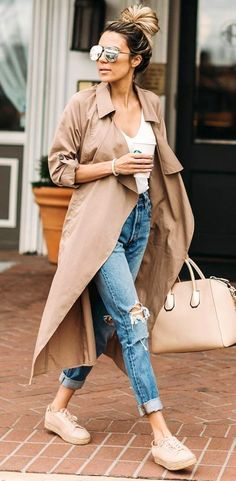 #winter #outfits white V-neck top, brown long coat, and distressed faded blue jeans