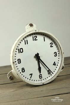 Reclaimed unusual cast iron hanging clock.  External diameter is 48cm excluding lugs (internal approximately 43cm).