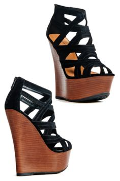 Get high and mighty! Sculpted Faux wood wedge featuring lush straps with caged design and back zip to secure your step. In 3 colors Blue, Black, and Red!