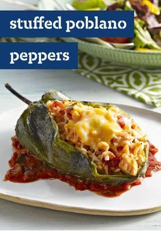 Stuffed Poblano Peppers (Chiles Rellenos) -- In this recipe, large poblano chiles get a stuffing of chicken, cheese, and chunky salsa and emerge from the oven hot, melty and delicious!