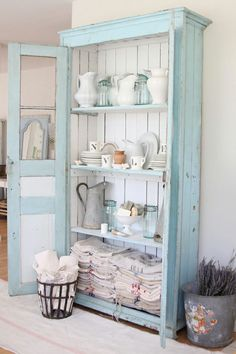 I want to do this with a corner hutch my mom gave me.  Same colors, same rustic idea.  Love it.