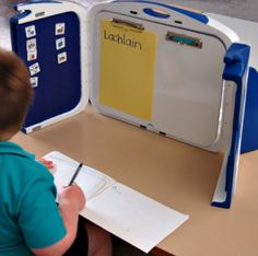 Study nook on desk top to reduce distractions for ASD pupil