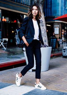 Viva Luxury wearing Adidas and a polished blazer.