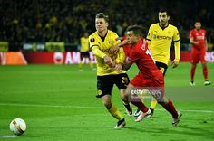 Philippe Coutinho of Liverpool and Lukasz Piszczek of Borussia Dortmund batle for the ball during the UEFA Europa League quarter final first leg match between Borussia Dortmund and Liverpool at Signal Iduna Park on April 7, 2016 in Dortmund, Germany.