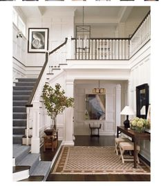 Love the brown entry carpet and blue runner