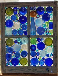 bottle bottoms on a window, made by Yvette Glass Bottle Crafts, Sea Glass Crafts, Stained Glass Crafts, Stained Glass Patterns, Bottle Art, Glass Bottles, Mosaic Bottles, Mosaic Glass, Broken Glass Art