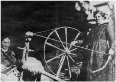 Daughters of Jake Blevins, Elitha Blevins Thomas and Arbanna Blevins, demonstrate use of spinning wheel. Scott County, Tennessee