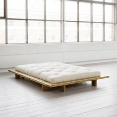 The minimalist Karup Japan bed complements any decor. Slat frame included. Solid pine. Please Note: The futon is NOT included. H 19 cm / W 168 cm / D 218 cm Please allow 4-6 weeks for shipping. $340