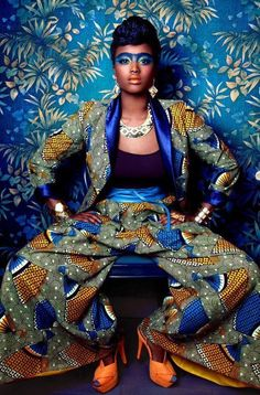 Vivacious blue and yellow African print jacket and trousers.
