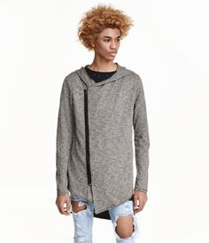 Cardigan in slub jersey with raw edges, a hood, diagonal zip at front, and asymmetric hem.