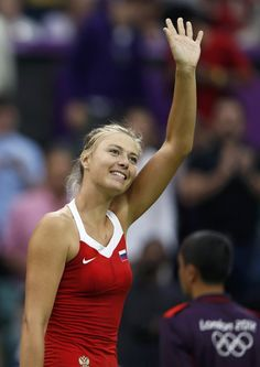 Russia's Maria Sharapova waves to the spectators after winning her women's singles tennis match against Israel's Shahar Peer at the All England Lawn Tennis Club during the London 2012 Olympics Games July Maria Sharapova, Miss And Ms, My Maria, Lawn Tennis, Tennis Players Female, Tennis Match, Tennis Clubs, The Spectator, Serena Williams