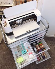 Organizing My Craft Closet With Cricut. Organizing My Craft Closet With Cricut - Lela Burris. How to organize a craft closet with a Cricut Maker, plus storage solutions for Cricut machines. Craft storage is dressed up with vinyl labels and wallpaper. Craft Room Storage, Craft Organization, Craft Room Closet, College Desk Organization, Scrapbook Room Organization, Scrapbook Rooms, Organize Craft Closet, Business Office Organization, Organizing Ideas For Office