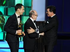 Jim Parsons and Bob Newhart present the award for  'Best Writing for a Variety Series Award' to Stephen Colbert during the 65th Annual Primetime Emmy Awards held at Nokia Theatre L.A. Live on September 22, 2013 in Los Angeles, California.