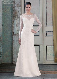 Beaded tulle straight gown with illusion sleeves and back, accentuated with a sabrina neckline. https://www.justinalexanderbridal.com/signature_wedding_dresses/9786