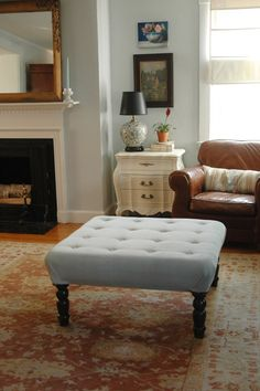 create an upholstered ottoman out of a coffee table. via Little Green Notebook.