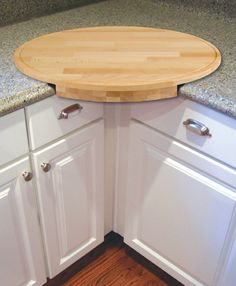 Round corner cutting board. Convenient way to use up that corner space.
