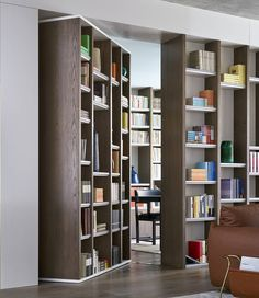 The joinery from The Books House, features that classic element of all grand private , a hidden pivoting door that conceals a quiet study beyond. The shelves feature opaque honeycomb acrylic that allows the light to filter through. Joinery, Contemporary Furniture, Bookcase, Furniture Design, New Homes, Shelves, Doors, Interior Design, Architecture