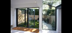 frameless glass window and aluminium bi fold doors to rear of modern extension Flat Roof Materials, Roofing Materials, Living Area, Living Spaces, Glass And Aluminium, House Extensions, Open Plan Living, Glass Design, Home And Family