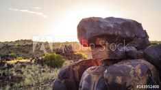 Stock Video of Push in linear timelapse at sunrise with rock formations in the foreground looking onto the Karoo landscape in the background, scattered clouds moving away from camera with flare from behind the rock available on request. at Adobe Stock Moving Away, Rock Formations, Geology, Stock Video, The Rock, Stock Footage, South Africa, Adobe, Sunrise
