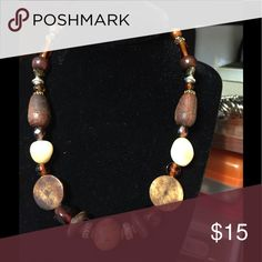 Unusual necklace in brown and beige Brown and beige with silver spacers Jewelry Necklaces