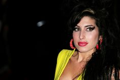 Amy Winehouse - eyeliner: cat eye lipstick: deep or bright red  funky earrings and ciggarettes