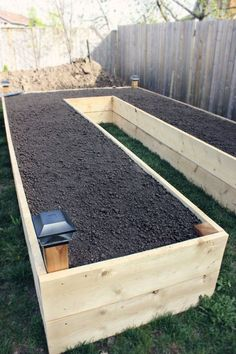 This is a raised bed garden idea that gives you walking space to water all of the plants. So smart!