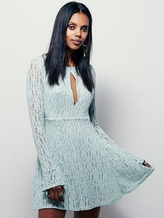 Lacey Fit And Flare Dress | Lace fit and flare dress with long sleeves. Keyhole cutout at the bust with double hook-and-eye closure. Fully lined.