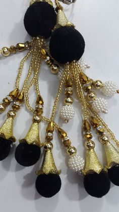 hangings or accessories attached at the back of a sari blouse which gives a sensual look.My blog on that coloqually called 'Ladkand""