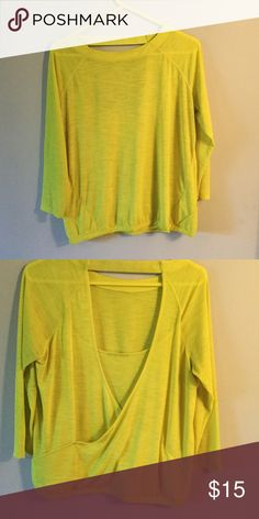 Athleta top. Sheer yellow. Back open. Great to wear over cute sports bra. Tag cut out because it kept sticking out but the top was only worn once. Perfect condition Athleta Tops