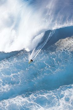 A helicopter view of big wave surfer, Tony Ray surfing a hiuge wave at Phantoms, on Oahu's north shore.