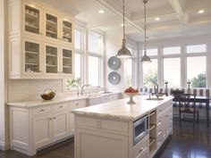 Basic white kitchen with dark wood floors to make it pop.  Love the beamed ceiling.