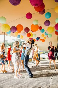 Rainbow of Hanging Paper Lanterns | Bright Music Festival Wedding | Outdoor Stretch Tent Reception | Ronald Joyce Wedding Dress | Jessica Reeve Photography | http://www.rockmywedding.co.uk/jes-tommy/