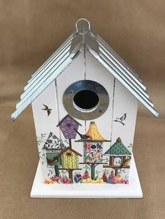 Lovely Hand Finished Bird House, finished in Elegance White, with Vintage Bird Houses detail applied to the face.  This Bird House can be put to use outside, it has been sealed, to protect from the weather, and has the corrugated roof, so not only looks something special, it is also fully weatherproof for the family that choose to use it.  It has the 25mm hole, in the front, so will be used by birds such as Blue Tits and Finches. There is a hanging loop on the top if you wish to hang it from…