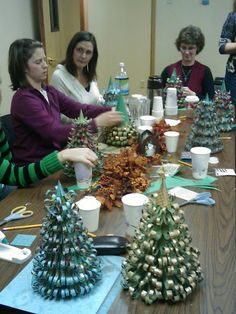 paper curl Christmas trees - tutorial says it takes 1 hour. But if the cones are precut, and the strips of paper precut, think we could do it in one meeting?