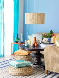 Bohemian Chic  Mixing cool blue with aqua, orange, and rattan accents creates an eclectic room. Floor cushions and low furniture make seating fun and casual.