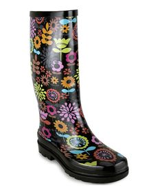 Puddles won't stop those runway struts with these stylish rain boots. Anything but drab, this pair features a classic silhouette, artistic design and eye-catching colors that are sure to shed some bright light on any gray day.