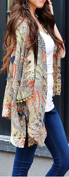 I actually own this peacock kimono - and luv it; the print and colors are great for summer and transitioning into fall.