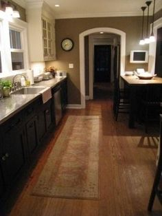 White upper and black lower kitchen cabinets. Mouse brown dark taupe walls by carlvez