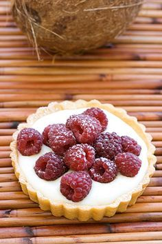 The berries are topping the coconut pastry cream filling and a thin layer of raspberry-white chocolate ganache below. And yes, there's more coconut in the tart shells, too.  Sounds delicious!