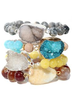 Gemstone beaded stretchy bracelets with a druzy connector. Perfect for layering bracelets. From top to bottom: 1.Gray (top) 2.Turquoise 3. Yellow 4.Brown(bottom) One size fits all.