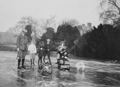 "A group photograph including King Edward VIII, later the Duke of Windsor (1894-1972) when Prince Edward of Wales; Mary, Princess Royal and Countess of Harewood (1897-1965) when Princess Mary of Wales and Prince Henry, Duke of Gloucester (1900-74) when Prince Henry of Wales; Prince George, Duke of Kent (1902-42) when Prince George of Wales; and Prince John (1905-19) when Prince John of Wales, with Peter Hansell (1863-1935) and another attended, possibly called Jones, and nanny  ""Lala""."